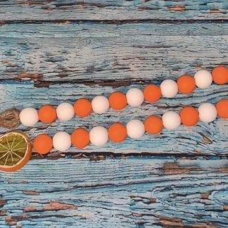 orange and white wood bead garland