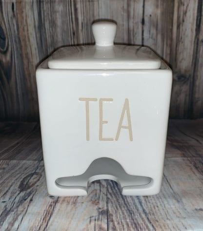 Tea packet dispenser